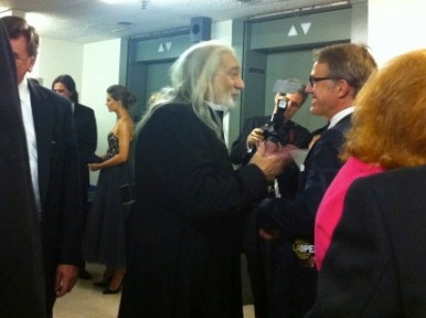 "Placido Domingo greeting actor Christoph Waltz backstage after the show, with Stana Katic in the background: Opening night of ""I Due Foscari"" at LA Opera (photo by @jozjozjoz)"