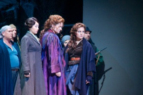 Patricia Bardon (Carmen, fourth from left, in purple) between Hae Ji Chang (Frasquita) and Cassandra Zoé Velasco (Mercedes) with Ensemble
