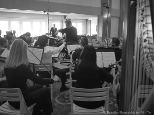James Conlon rehearsing SMHS chamber orchestra (behind in BW)