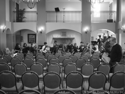 James Conlon rehearsing SMHS chamber orchestra (front in BW)