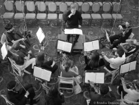 James Conlon rehearsing SMHS chamber orchestra (overhead in BW)