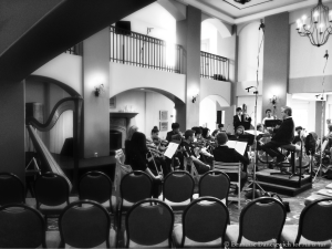James Conlon rehearsing SMHS chamber orchestra (side in BW)