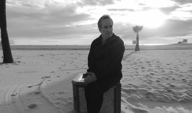 James Conlon sitting down at Santa Monica beach 2
