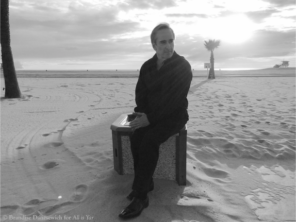 James Conlon sitting down at Santa Monica beach 2